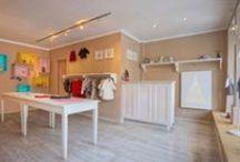 Gugudada / Projekt wnętrz sklepiku z używaną odzieżą dziecięcą.