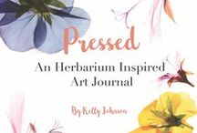 Pressed: An Herbarium Inspired Art Journal / Do Flowers fall out of all your books? Want to learn to collage the delicate beauty of pressed flowers into a collection of your own? Then you are ready for Pressed: An Herbarium Inspired Art Journal is the new book by Wings, Worms, and Wonder! Pick, Press. Paste, and Pen your creative nature connections in this guided flower pressing nature art journal!