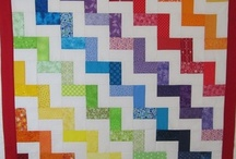 """Scrappy Quilts / Quilts made by Carol Steely of funthreads.blogspot.com. Most were made as charity quilts. Some were made from """"puzzle bags"""" of scraps from my quilt guild. These are random bags of pieces that our guild gives out. The puzzle is to make a usable quilt from it:)"""