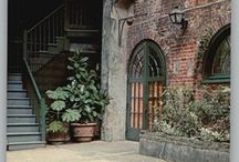 Courtyard & Gardens: Bayou House / Architecture inspiration for the courtyard of the house we plan to build on the bayou. Brick, greenery, solid wood, French Creole awesome.