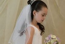 First Communion Dresses Style 6815 / Beautiful long length first communion dress. This satin communion gown is available exclusively at Christian Expressions