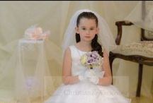 First Communion Dress Style 6811 / Long length first communion dress made of satin with layered organza. A Christian Expressions exclusive.