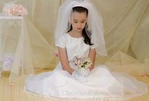 Girls First Communion Dress Style V955 / Girls first communion dress made of satin with organza overlay. All over embroidery and scalloped lace hem. This long length first communion gown is a Christian Expressions exclusive.