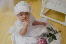 Girls Cotton Christening Gown / Beautiful cotton christening gown for girls with daisy flowers. Pearl button back and tie closure http://www.christeningapparel.com/christening-gowns/baptism-dresses/kiera-christening-gowns.html