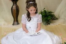 Organza and Satin First Communion Dress Style 6806 / Gorgeous long length communion gown with satin and organza overlay with allover embroidery flowers. Satin buttons in back with zipper closure. Large flower on waistline. Fully lined. Available in tea length and long length  http://www.firstcommunions.com/firstcommuniondresses-6806.aspx
