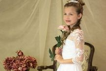 Stunning FIrst Communion Gown Style 8020 Season 2015 / First communion gown made of satin with organza overlay Available exclusively through Christian Expressions.  http://www.firstcommunions.com/first-communion-dresses-8020.aspx