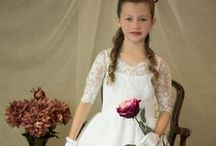 First Communion Dress Style 8021 New for Season 2015 / Classic style first communion dress with lace bodice and three quarter sleeves.  New for first communion season 2015 . This first communion gown is available exclusively through Christian Expressions. http://www.firstcommunions.com/first-communion-dresses-8021.aspx