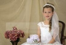 Lace with Beading First Communion Dress Style 8024 / Tea length first communion dress with lace bodice embellished with pearl beading., Organza overlay tea length skirt. Organza flower on waist. Zipper back. New for season 2015 http://www.firstcommunions.com