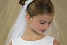 Satin First Communion Dress Style 6805 / Classic first holy communion dress sleeveless satin with pearl design around waist. Satin buttons in back with large satin bow. Fully lined. Tea length. This first communion dress is available exclusively by Christian Expressions  http://www.firstcommunions.com/