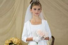 Satin and Pearls First Communion Dress with Jacket Style 6302 / Satin sleeveless  first communion dress, bodice dotted with pearls, organza A-line skirt. Jacket is piped in pearls, with sleeves. Satin/Organza. White.   http://www.firstcommunions.com/First-Communion-Dresses-6302.aspx