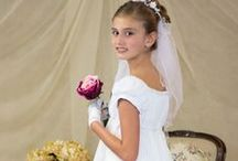 Tea Length First Communion Dress Style 5069 / Short sleeve satin first communion dress with hand beaded renaissance bodice.  Available exclusively at Christian Expressions  http://www.firstcommunions.com/first-communion-dresses-5069.aspx