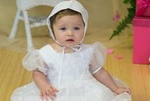 Irish Shamrock Christening Gown Style 9008 / Our delightful irish shamrock christening gowns are made of satin with overlay organza and has scattered shamrocks and flowers throughout. Satin buttons cover zipper back. Matching bonnet included.  http://www.christian-baby.com/