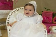 Organza christening gown with embroidered crosses for girls / This beautiful gown has a sheer overlay with delicately embroidered crosses at bodice and hemline. You can be assured that your little one will not only look beautiful in this gown, but feel comfortable in it too. In stock in all sizes while supplies last.  http://www.christian-baby.com