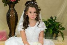 Beaded Tea Length First Communion Dress Style 6606 / Elaborate sheer first communion dress with wide satin hem, allover sequin embroidered bodice and novelty back . Tea length. Available in sizes shown while supplies last  This first communion dress is available exclusively by Christian Expressions.   http://www.firstcommunions.com/