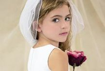 Satin and Lace Bodice Communion Dress Style 6812 / Satin Tea Length First Communion Dress Style 6812 (5 photos) Classic sleeveless tea length first communion dress with lace bodice and satin skirt. with large satin bow. Fully lined. Zipper back. Available exclusively at Christian Expressions   http://www.firstcommunions.com/