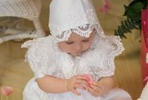 Beaded Satin Girls Christening Gown / Satin and Beading Girls Christening Gown (19 photos) Beautiful satin christening gown with heavy beading, attached beaded 'bib', scalloped, beading hem. Zipper back. Available at Christian Expressions online: http://www.christian-baby.com/