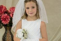 Satin Tea Length First Communion Dress Style 5375 / Satin first communion dress with diamond quilted bodice w/ striped fancy organza overlay. Accented w/ flower on the waist.  http://www.firstcommunions.com/first-communion-dresses-5375.aspx