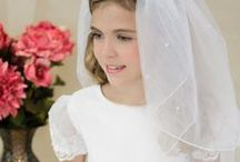 Satin with Beading Tea Length First Communion Dress Style 5099 / Satin first communion dress with sheer sleeves with appliques. White. Tea Length .This first communion dress is available exclusively by Christian Expressions  http://www.firstcommunions.com/First-Communion-Dresses-5099.asp