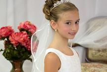 Satin and Flowing Organza First Communion Gown / This first communion dress is absolutely stunning! Satin bodice with beaded design. Skirt is tea length and has double layer long length organza. Satin cumberbun with satin bow. Zipper back. Color: white. Long length   http://www.firstcommunions.com