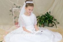 Beaded First Communion Gown Style 6301 / Gorgeous organza first communion gown with all over beading. Sleeveless gown with zipper back and satin buttons. Matching short sleeve organza jacket included. This first communion gown is available exclusively through Christian Expressions. http://www.firstcommunions.com/