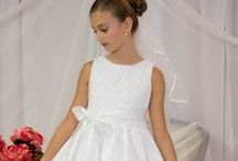 Crochet First Communion Dress / Tea length satin first communion dress with crochet bodice and satin tie bow (bow can be tied in front or back) Zipper back  Available exclusively at Christian Expressions  http://www.firstcommunions.com/
