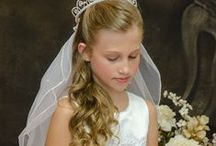 First Communion Dress Style Ashley / Sleeveless  first communion with glittered skirt and satin bodice with lace accented with pearls and rhinestone beading. Fully lined. Tea length. Made in the USA. New for Season 2016