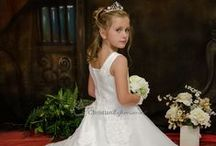 First Communion Dress Style Diana / Full length satin and organza heavily beaded communion gown. Sleeveless with pearl accented neckline with organza layer skirt and lace applique and pearl beading. Fully lined This first communion dress is available exclusively at Christian Expressions and our authorized websites