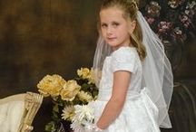 First Communion Dress Style Jennifer / Short sleeve satin tea length first communion dress with corded lace design on netting.   Zipper closure with bow shantung satin tie back. Scalloped lace trim hem. Fully lined. The first communion dress is new for season 2016 and Made in the USA.