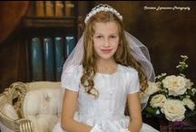 First Communion Dress Style LI-SP118 / Short sleeve first communion dress made of satin and organza overlay with detailed floral embroidery. Beautiful scalloped hemline with floral accents. Zipper closure with bow  tie. The first communion dress is new for season 2016 and Made in the USA. Available in plus sizes