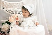 Girls Christening Gown Charlotte / Embroidered Organza Overlay Christening Gown  Beautifully embroidered girls white christening gown with tulle overlay.  This long baptism gown features three quarter sleeves with lace accents on sleeves and hem. Delicate flower on waist with pearl button closure and organza tie bow. Matching bonnet is included  This beautiful christening gown for girls is made in the USA