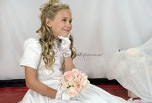 Satin Beaded First Communion Dress / This short sleeve, tea length satin first communion features heavy beading on bodice and beaded accents on waist. Zipper back with satin buttons. Available exclusively at Christian Expressions