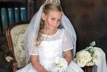 Embroidered Organza First Communion Dress / This popular first communion dress features satin and organza overlay with delicate embroidery and pearl accents. This girls first holy communion dress is available only at Christian Expressions