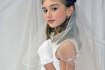 """First Communion Veil with Embroidered Scalloped Trim / This white first communion veil features two tier 27"""" with embroidered fleu de lis scalloped design along edge. This girls first communion veil includes attached comb. NOTE: tiara shown is sold separately. Price is for veil  only."""
