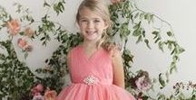 Flower Girl Dress Glitter Tulle Rhinestone Brooch / This Flower Girl Dress features tulle fabric with glitter to add sparkle. This tea length party dress includes a rhinestone brooch along the waist. This V Neck dress is available in many colors and sizes and is perfect for any special occasion including wedding, father daughter dance, Easter celebration, school functions and first communion. Sizes available to fit tweens.
