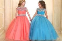 Girls Ball Gown with Cap Sleeves / This Girls Ball Gown features fully lined flowing long length tulle skirt, The bodice offers cap sleeves   This girls ball gown is available in many colors to fit any occasion including white, mint, champagne, hot pink, blush, white, royal blue, aqua, coral, turquoise, silver, lilac and is perfect for pageants, flower girl, first communion or any special occasion. https://www.firstcommunions.com/product/girls-ball-gown-with-cap-sleeves/