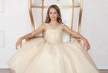 Girls Pageant Gown with Beaded V Neck and Scoop Back / This long length girls pageant dress is the perfect dress for your little girl's fancy special occasion. This beautiful girls dress features a v neck bodice with organza and lace appliques. The bodice features a beautiful applique design with heavy beading, and a full length tulle skirt with matching lining https://www.firstcommunions.com/product/girls-pageant-gown-with-beaded-v-neck-and-scoop-back/