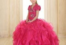 Girls Pageant Gown with Ruffled Skirt and Jeweled Embroidery / This  girls pageant gown is the perfect dress for your little girl's fancy special occasion. This beautiful girls dress features a fully lined, ruffled organza long length skirt. The bodice features a gathered design with jeweled embroidery throughout. A matching satin bolero jacket is included https://www.firstcommunions.com/product/girls-pageant-gown-with-ruffled-skirt-and-jeweled-embroidery/