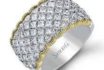 Simon G / Simon G. Jewelry is a family owned and operated luxury jewelry manufacturer in its 31st year of business. Throughout the last decade, Simon G. Jewelry has gained recognition as a leading brand in designing and producing bridal jewelry and engagement rings. Aside from producing some of the top diamond rings and wedding bands, Simon G. is also very well known for its fashion jewelry.