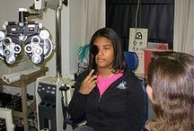 Exam and Treatment Photos -- Children / Photos showing various eye exams and treatments for children.