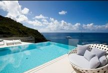 St. Barts / Located in the French West Indies near St. Martin and Anguilla, St. Barts (short for St. Barthélemy) captures visitors' hearts with its quaint, chic French atmosphere and relaxed, small-town charm. Groups of friends, families, and honeymooners can all enjoy the elegance of a villa in St. Barts:  http://www.villasofdistinction.com/destinations/st-barts/