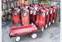 red wagon gardens / I love the rustic look of found objects in the garden - it seems a vintage radio flyer wagon is the perfect vehicle......easy to care for & charm galore