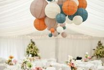 Ceiling Decor - tulle, sheer fabric, chinese lanterns, lights, etc. / Ceiling decor adds a cushion to the room.  It drops the height which gives the space a cozy feeling.