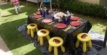 Partini Superhero Party / A Superhero 4th Birthday Party, featuring our kids size trestle table, ikea yellow stools and black chalk oilcloth table cover.  Spiderman web drawn using white chalk is such a cool feature!  One very happy little boy!