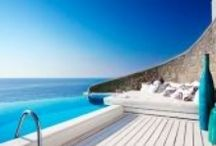 Mykonos at its sexy best / Cavo Tagoo with its cool cliffside caves vibe..