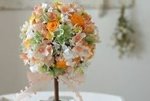 【トピアリー】 / 盆栽のようなまあるい形が特徴のトピアリー。 開店祝いやお誕生日のお祝いなど、どんな贈り物としても 喜ばれます、 アートやプリザーブドフラワーを素材にして製作しています。