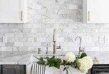 kitchen. / clean, white and bright with clever storage & beautiful, open spaces.