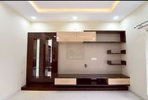 Residence: Mrs. Navneetha Reddy / Works done :  Living Room TV Unit with Mirror Artwork Informal Room TV Unit Puja with Glass Artwork Foyer Unit False Ceiling, Wall Paper, Painting