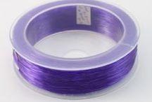 Fil élastique pour bijoux / Nous proposons un large choix de fils élastiques, transparents ou de couleurs variées, et de différentes épaisseurs, pour la confection de colliers, bracelets, et enfilage de perles