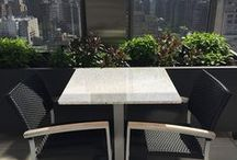 Hotel spaces / Hotels love making their customers feel at home. What better way is there than a table and chairs that can fit all of your travel companions, act as common ground for that business deal, or provide a relaxed setting for an end of day drink? Check out Cafe-Tables.com for tables to fit every common space in your hotel.