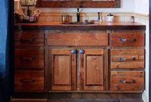 A Roughing It Bathroom / Custom made, rustic bathroom vanities and mirrors made out of 100 year old reclaimed barnwood.